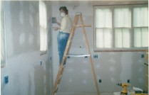 Tapeing, floating, and sanding kitchen walls