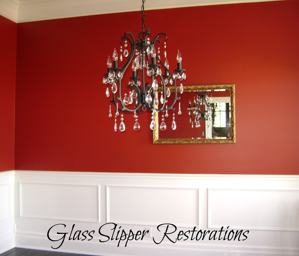Dining room with red walls and faux wainscoting (picture frame mouldings)
