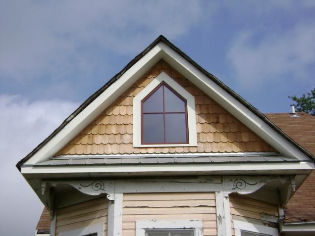 Gable with custom window and fish-scale cedar shingles