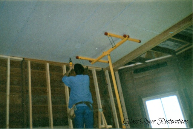Gary installing drywall in dining room